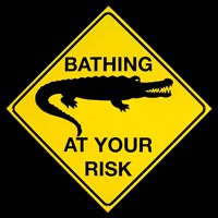 ROAD SIGN REQUINS SURFING AT YOUR RISK - Plaque métal 34x34 cm